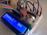 单片机MQ-2烟雾检测+ADC0809 AD转换+lcd1602显示程序
