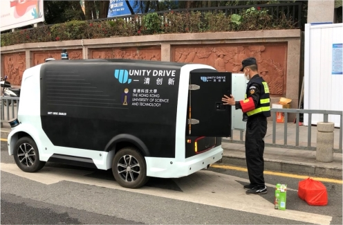 Self-driving vehicle developed by Unity Drive Innovation (UDI) delivers meals to checkpoint workers
